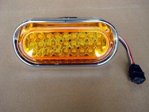 "Bumper Light Assembly: Oval Amber 6"" LED w/ Screwless Bezel & Grommet"